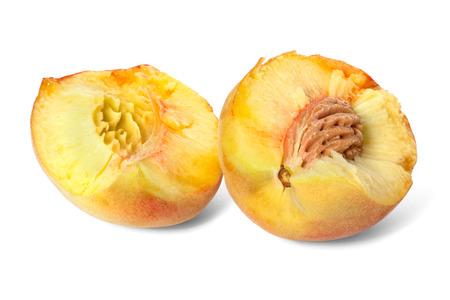 broken down: broken down into two parts ripe peach Stock Photo