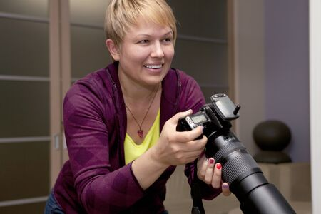 female photographer: female photographer taking pictures indoors Stock Photo