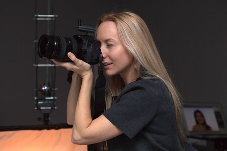 glee: female photographer taking pictures indoors Stock Photo