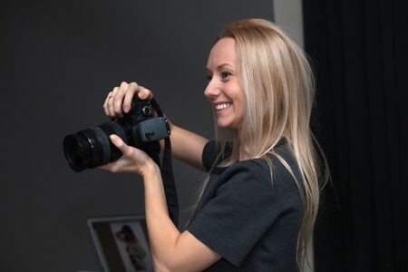 indoors: female photographer taking pictures indoors Stock Photo