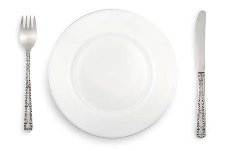White plate, fork and knife on a white background Stock Photo