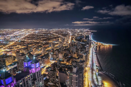 The shore of Lake Michigan with the city blocks of Chicago at night Stock Photo