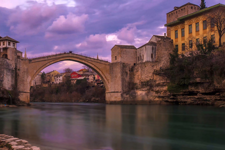 Old stone bridge across Neretva in Mostar in the evening Stock Photo