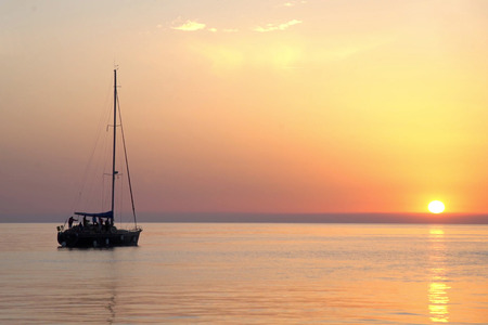 Fishing boat at sunset in the Adriatic Sea