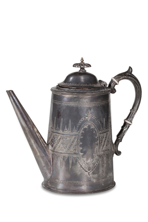 Old metal coffee pot with a lid on a white background