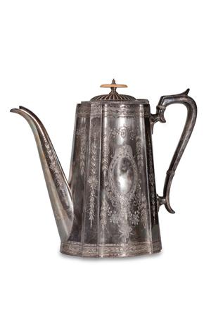 Old metallic teapot on a white background