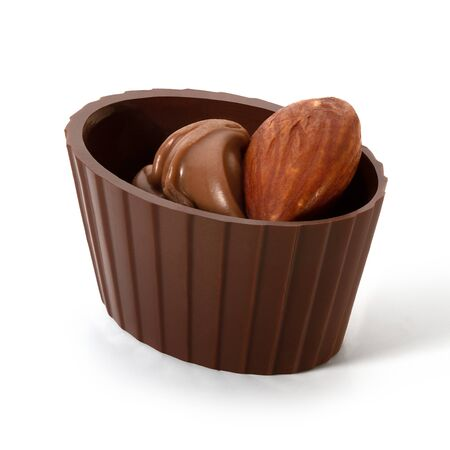 Small chocolate basket with cream and nut on a white background