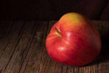 Textured ripe apple on old wood Stock Photo