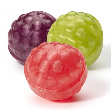 Three balls of caramel like raspberries of different colors