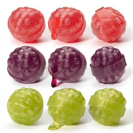 Nine different color balls of caramel like raspberries