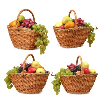 Four wicker baskets with fruits on a white background