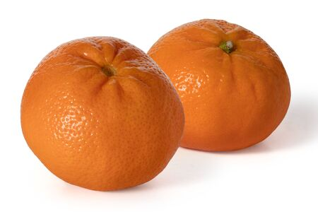 Two whole ripe tangerines on a white background