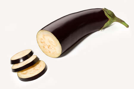 Ripe eggplant with cut pieces isolated on white background. Full depth of field.
