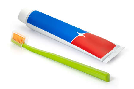 A tube of red and blue toothpaste and a toothbrush on a white background. Full depth of field. With clipping path.
