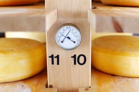 maturing: Thermometer and Hygrometer in a cheese cellar, allowing for correct temperature and humidity during the maturation of the cheese Stock Photo