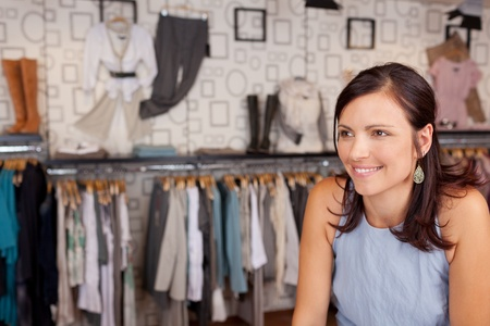 Mid adult smiling woman in clothing store photo