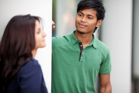 young man looking at his girlfriend in the city