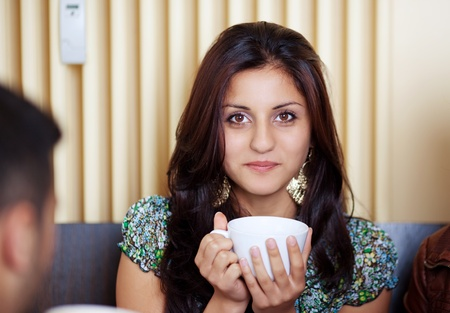 Beautiful woman is holding a cup of tea Stock Photo - 20651502