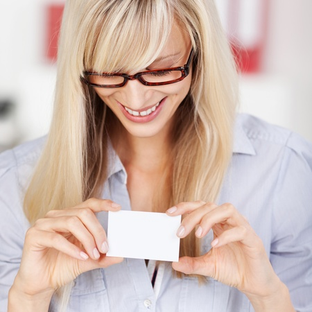 Pretty Caucasian female looking on white sticky note photo