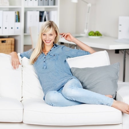 Happy Caucasian woman relaxing in living room area photo