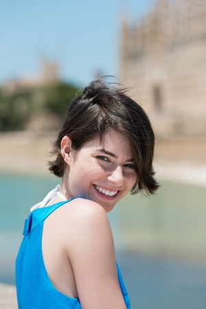 woman short hair: Close up portrait of young attractive smiling woman outdoors