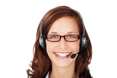 Smiling friendly attractive female call centre operator wearing a headset and glasses looking directly at the camera, headshot portrait on white photo