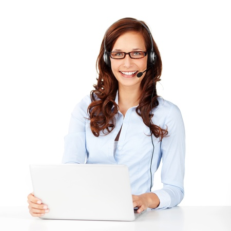 Smiling call center operator wearing headphone and browsing the internet photo