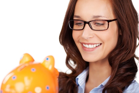 thrift box: Closeup portrait of a smiling woman wearing glasses holding her yellow ceramic piggy bank in her hands, isolated on white