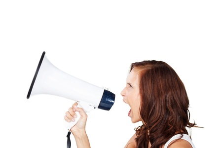 loud: Profile view of an attractive young woman shouting into a loud haler or megaphone making an announcement or to get attention, isolated on white Stock Photo