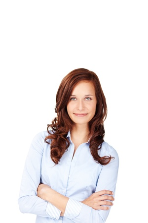 brown hair blue eyes: Causal female in curly hair posing with arms crossed Stock Photo