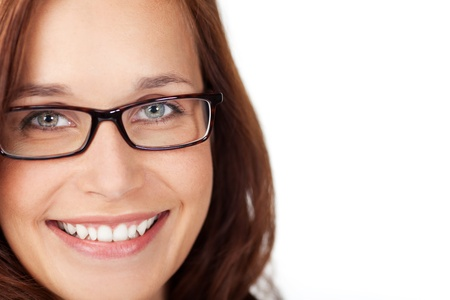 Smiling woman with glasses in a close up shot