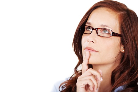 eye sight: Head portrait of an attractive thoughtful pensive young woman wearing glasses with her finger to her chin looking upwards in contemplation isolated on white Stock Photo