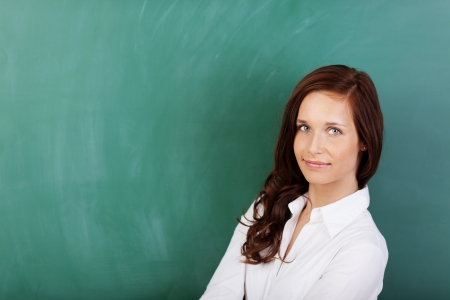 lecturing: Beautiful woman posing over the green board