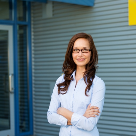 Portrait of an arms crossed businesswoman posing outdoors photo
