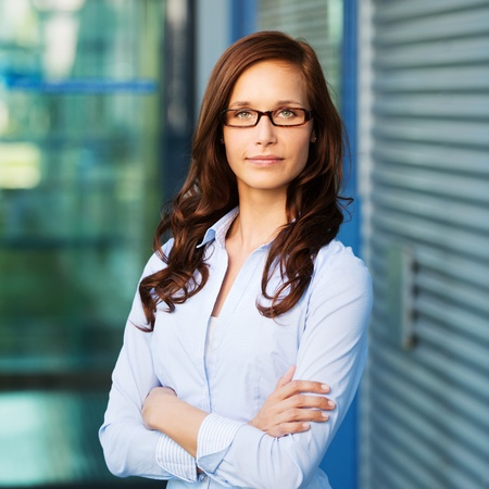 Portrait of a beautiful confident female executive, looking into the camera. photo