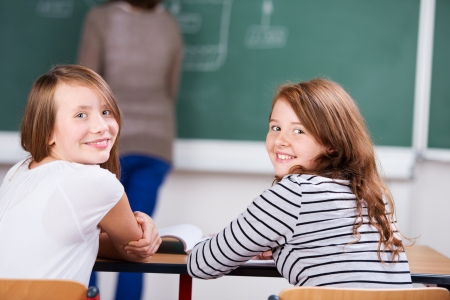 Young students sitting on chair during the class in schoolroom Stock Photo