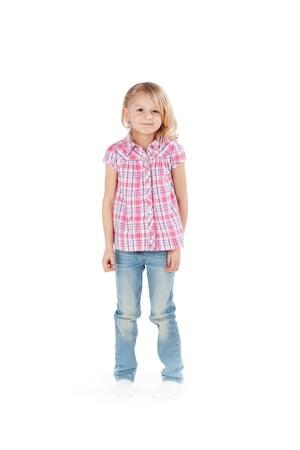 facing: Full length portrait of cute little girl standing isolated over white background