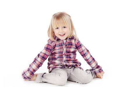 fringes: Full length portrait of cute girl sitting isolated over white background Stock Photo