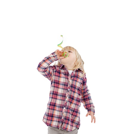 fringes: Little girl in blowing ribbon while standing isolated over white background