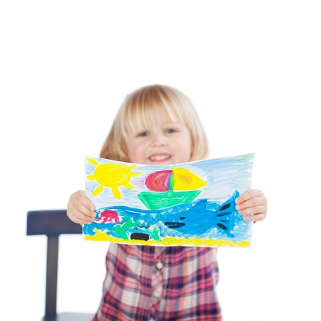 fringes: Portrait of proud little girl showing her painting isolated over white background