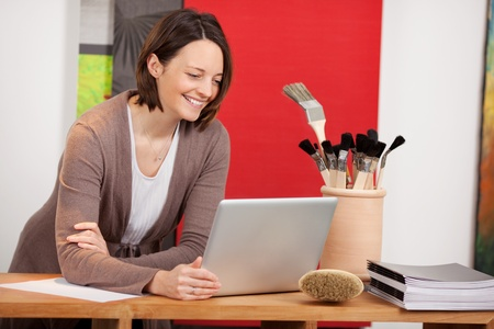 woman planning interior design with laptop in a store photo