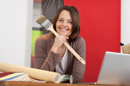 smiling woman working in an interior design shop photo