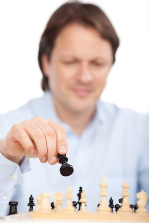 pawn adult: Chess player ponders about his next move