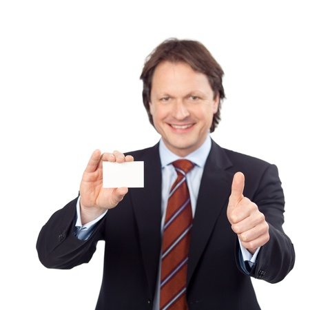 credentials: smiling businessman showing white card and thumb up sign