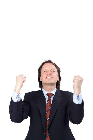 jubilation: Exultant businessman raising his fists in jubilation as he celebrates a victory or success isolated on white