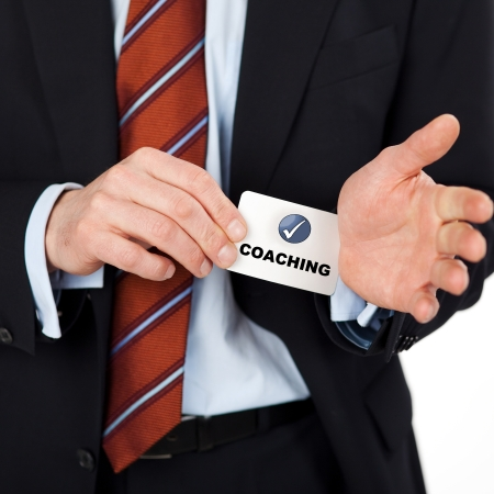 businessman pulling coaching card out of his sleeves photo