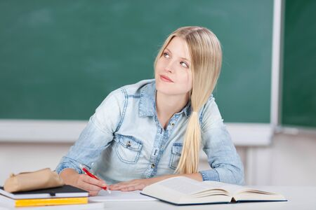 Female student is listening and writing minutes photo