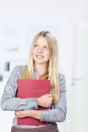 Young woman with a red application folder Stock Photo