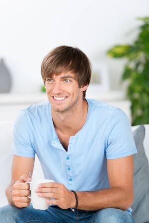 smiling man at home with cup of coffee Stock Photo - 21109367