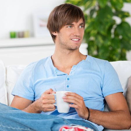 smiling man at home with cup of coffee Stock Photo - 21109368